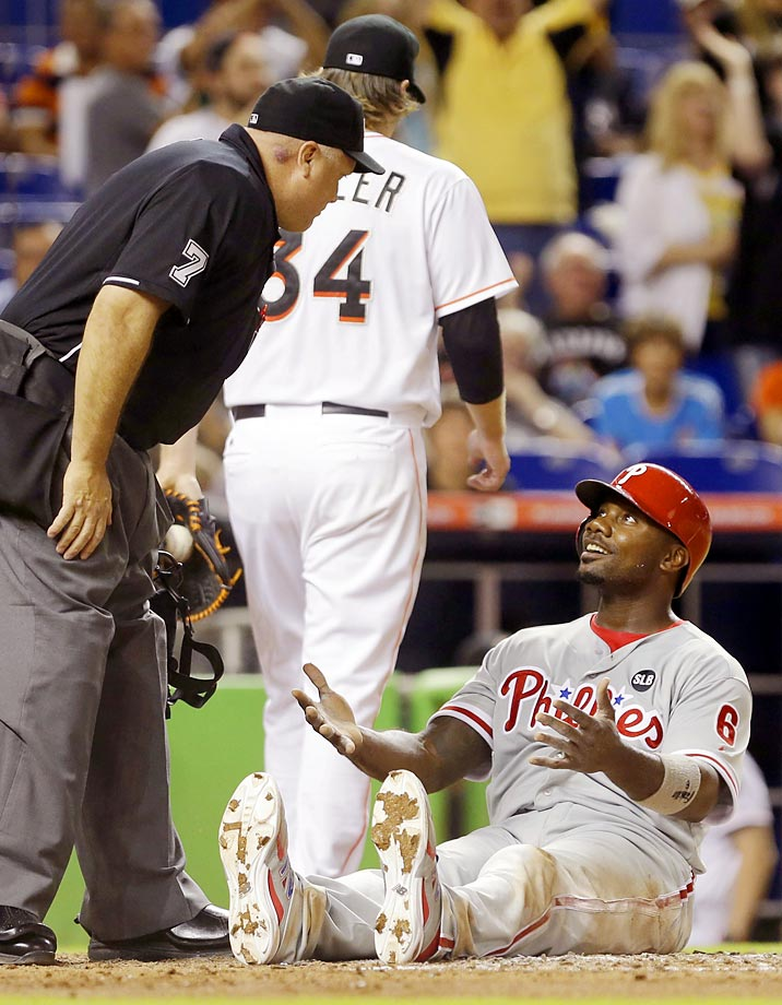 Ryan Howard of the Phillies smiles as he questions a call by home plate umpire Brian O'Nora.