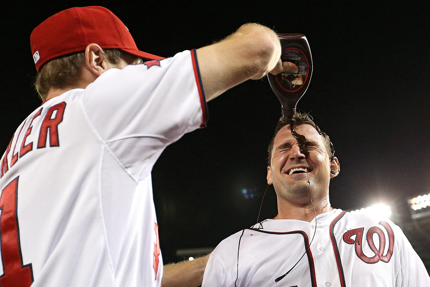 Ryan Zimmerman of the Washington Nationals is doused with chocolate by Max Scherzer after hitting a two run walk-off home run in the tenth inning against the New York Yankees.