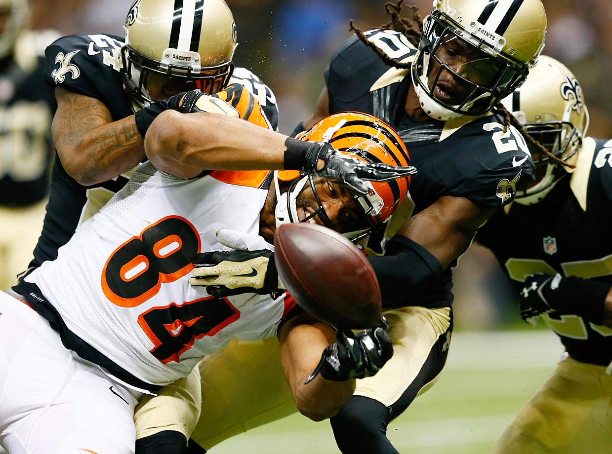 Corey White of the New Orleans Saints forces a fumble by Jermaine Gresham of the Cincinnati Bengals. Gresham recovered the ball in the end zone for a touchdown. The Bengals won 27-10.