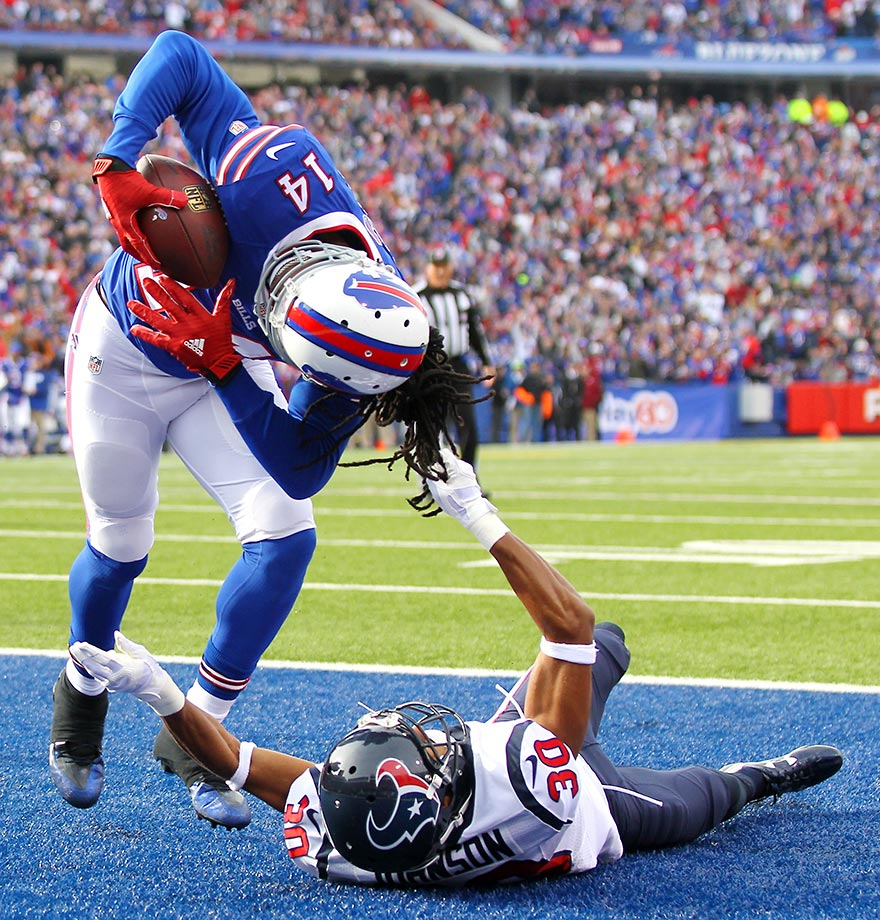 Sammy Watkins of the Buffalo Bills gets tugged by Kevin Johnson of the Texans, but still makes the touchdown catch.