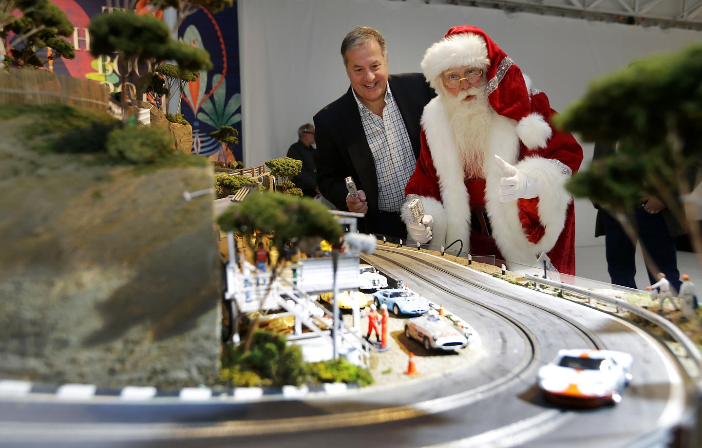 Brady Smith, as Santa Claus, and David Beattie check out the Slot Mods USA Ultimate Slot Car Raceway during the unveiling of the Neiman Marcus Christmas Book. The 1:32 scale model race track costs $300,000.