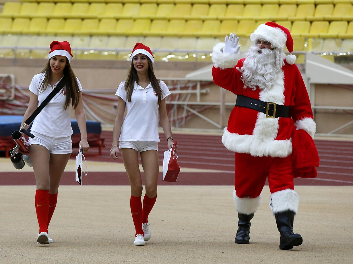 Santa and his helpers during the French L1 football match between Monaco and Saint Etienne.