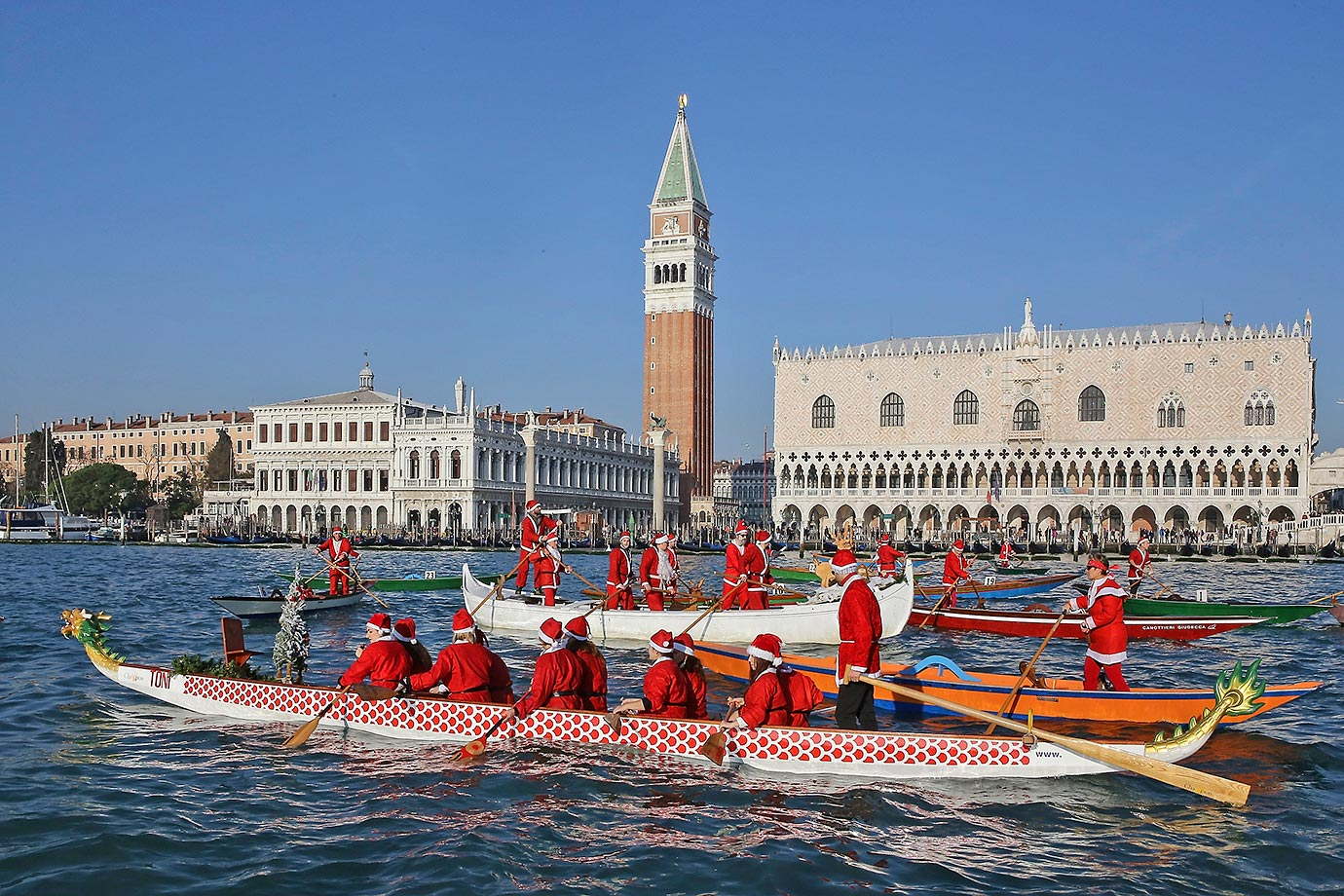 Rowers dressed as Santa get ready to race in the annual Father Christmas Regatta on the Grand Canal in Venice.