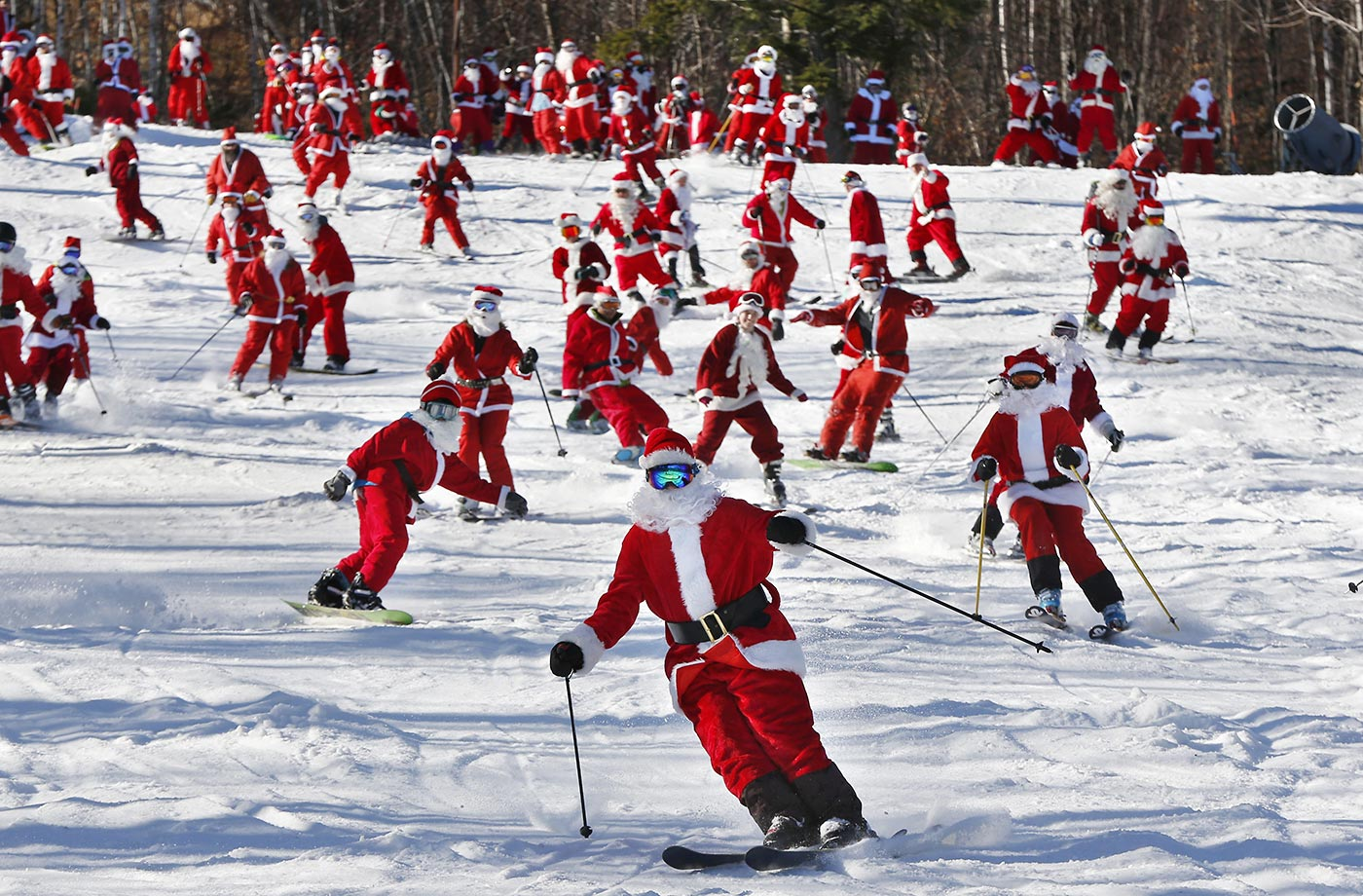 Santass take to the slopes at the Sunday River ski resort in Maine.