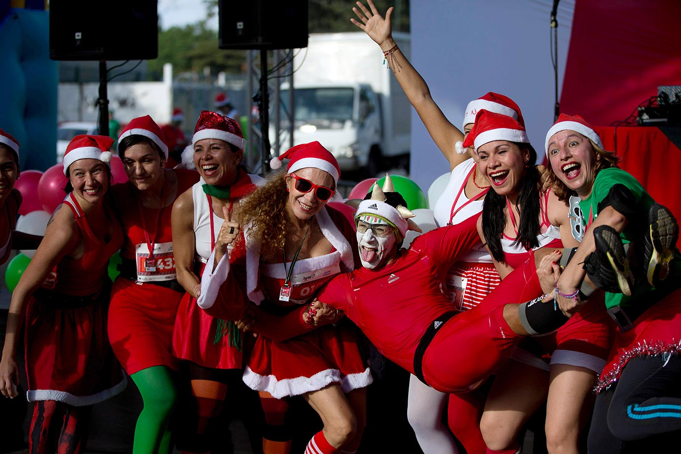 Runners dressed as Santa pose for a photo after finishing the Santa Claus Run in Caracas, Venezuela.