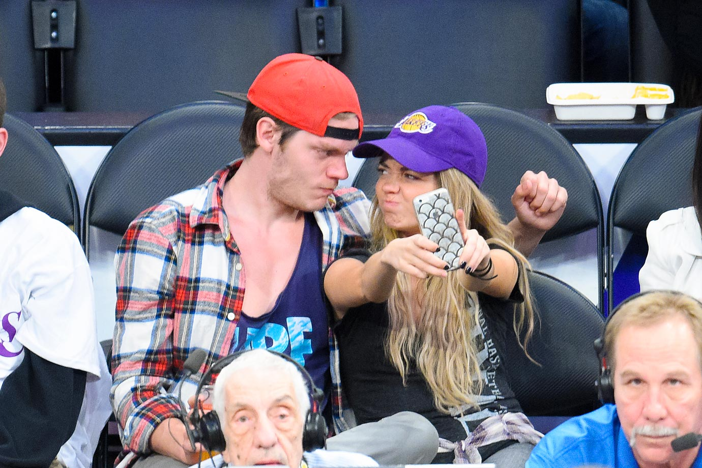 Actress Sarah Hyland and Dominic Sherwood pose for a selfie while at a game between the Dallas Mavericks and the Los Angeles Lakers.