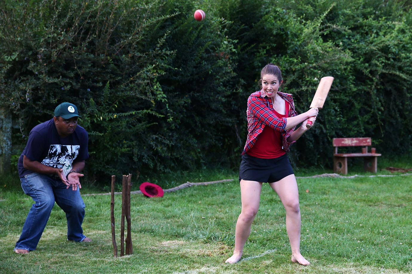BMX racer Sarah Walker plays a shot during a backyard cricket match, captained by Kiwi cricket greats Sir Richard Hadlee and Stephen Fleming, - under the famed 'party tree' at Hobbiton movie set.