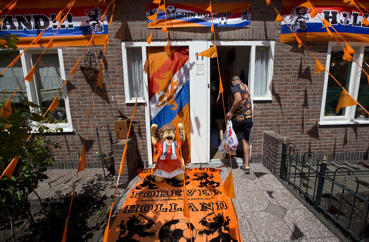 A man enters his house decorated in the colors of the Dutch soccer team in Amsterdam, Netherlands, on June 12. The Netherlands plays its first World Cup Group B match against Spain on Friday June 13.