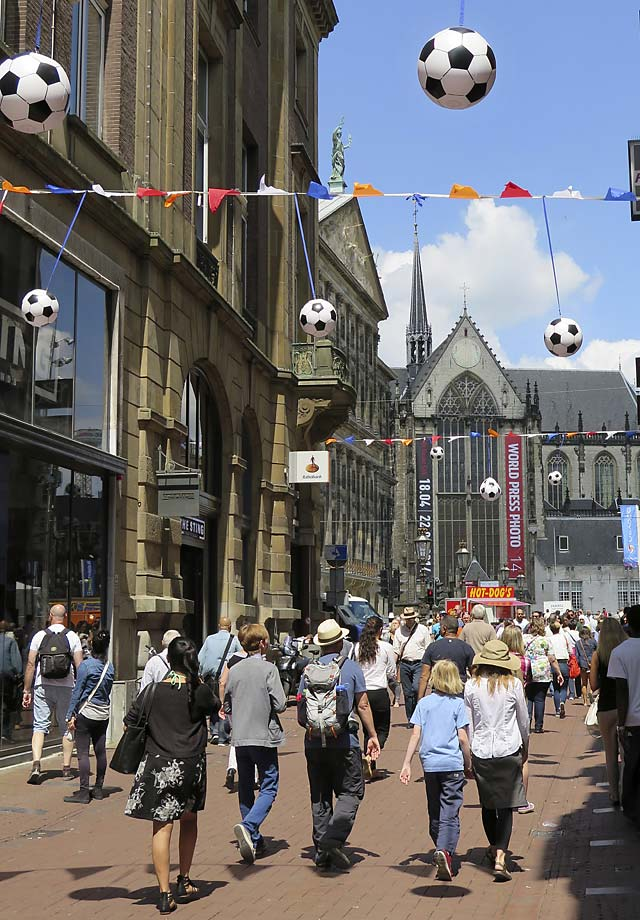 People walk under World Cup soccer decorations in the Kalverstraat in the center of  Amsterdam, June 12. The Netherlands plays its first World Cup Group B match against Spain on Friday June 13.