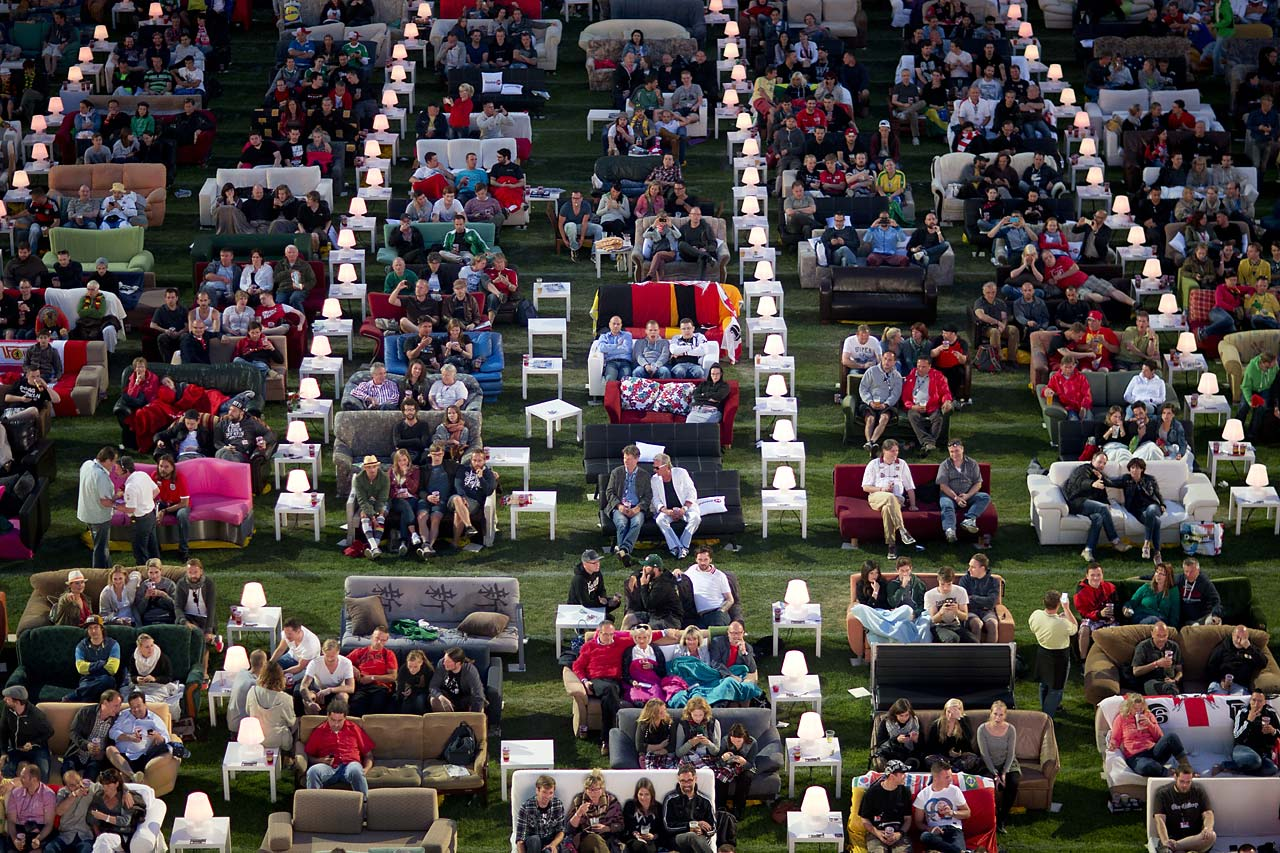 German soccer fans watch the opening game of the soccer World Cup 2014 while sitting on sofas in the 1.FC Union stadium in Berlin, Thursday, June 12, 2014.