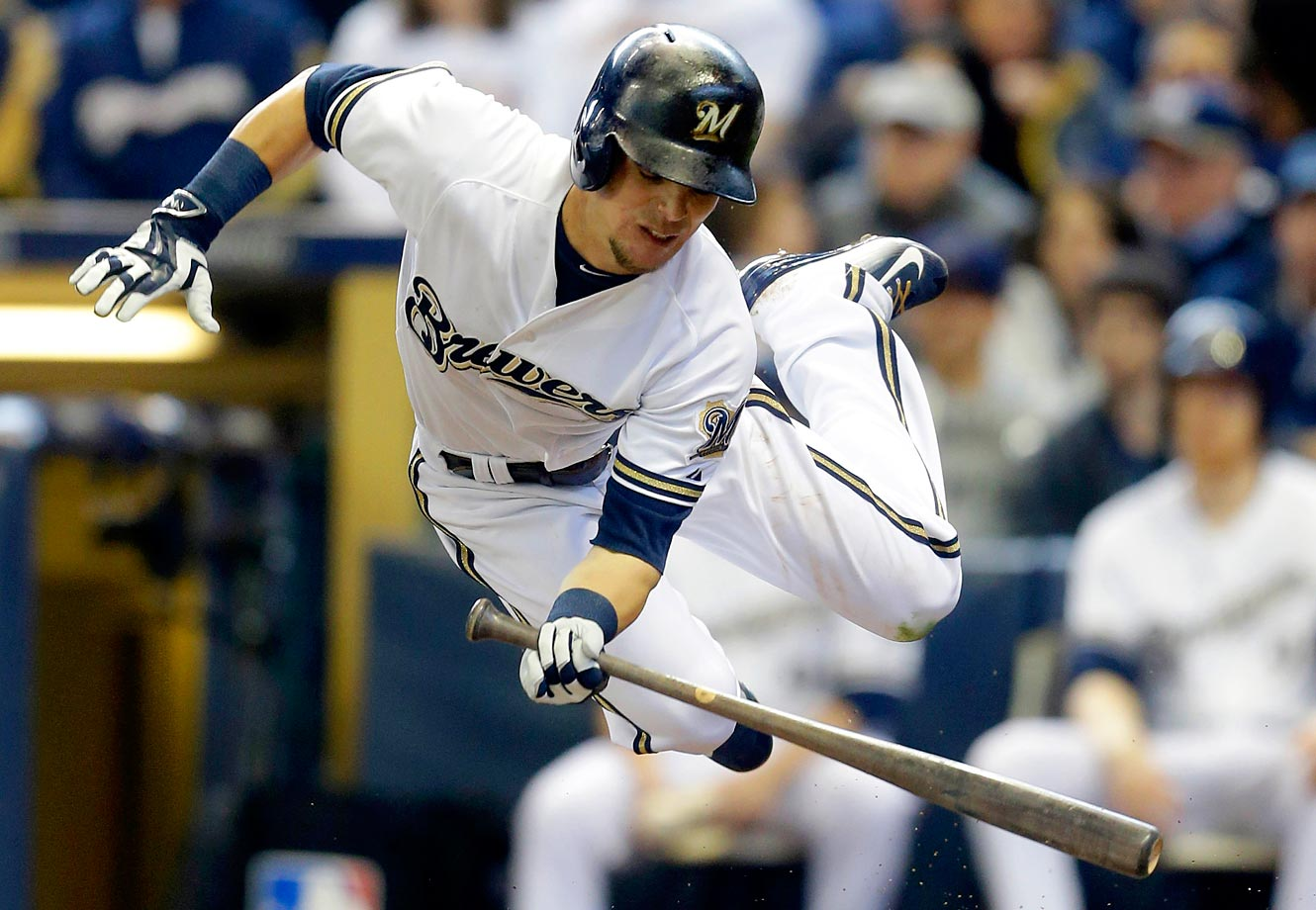 Scooter Gennett of the Brewers makes a great effort but still gets hit by the pitch against the Colorado Rockies.