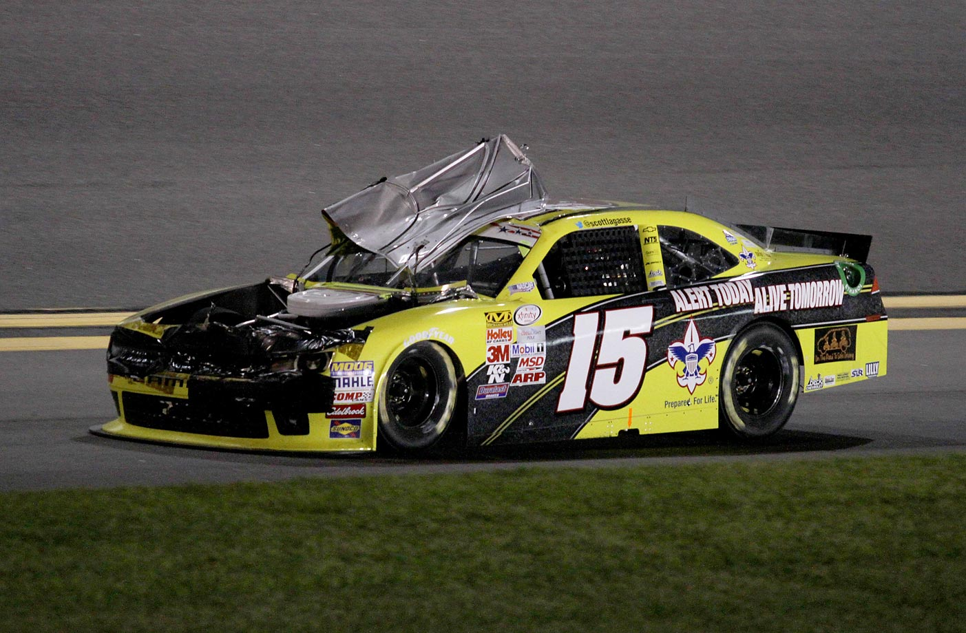 Scott Lagasse Jr. loses his hood during the NASCAR Xfinity Series Subway Firecracker 250 in Daytona.