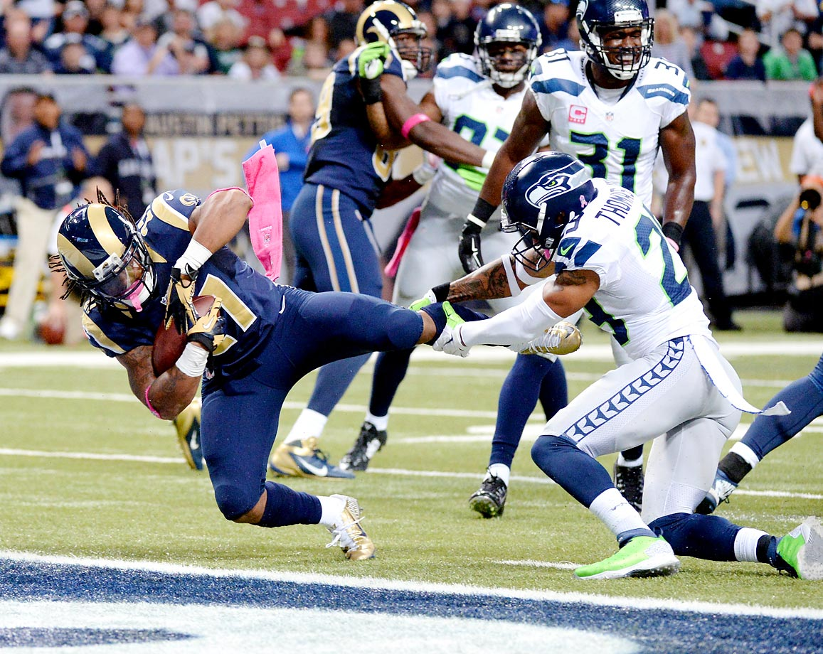 Running back Tre Mason scores a touchdown in the Rams' 28-26 victory over the Seahawks.