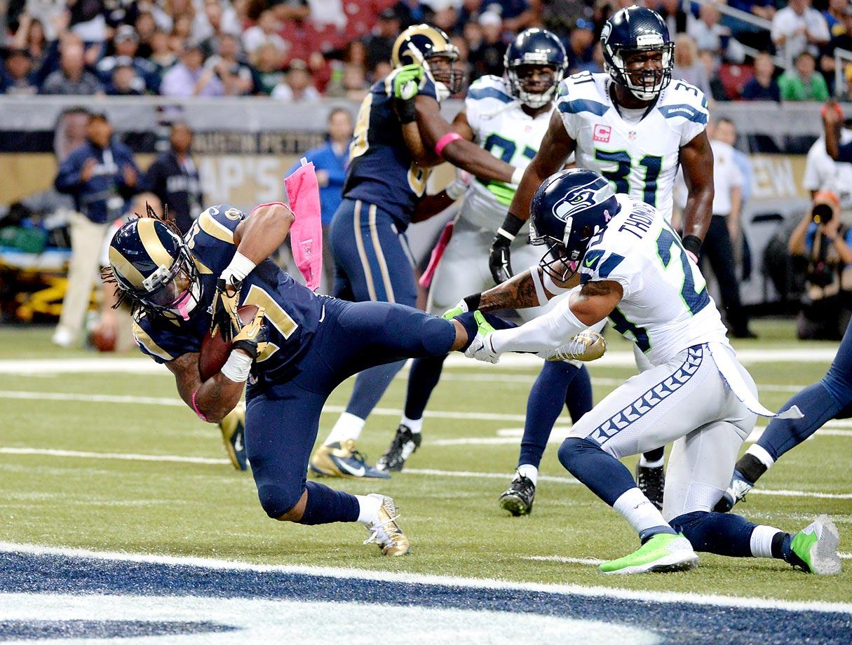 St. Louis Rams running back Tre Mason scores a touchdown against the Seattle Seahawks.
