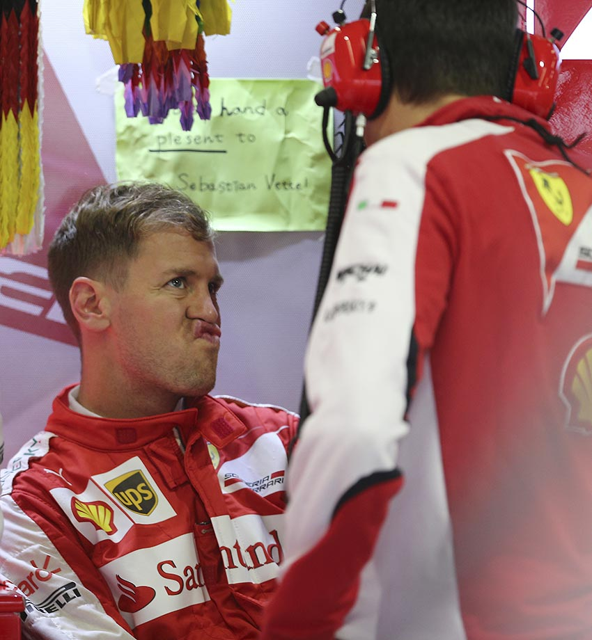 Sebastian Vettel shows a funny face during a practice session for the Japanese Formula One Grand Prix.