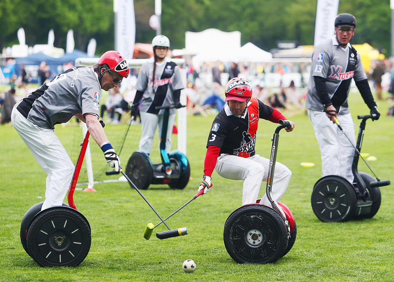 Players of  Funky-Move Turtles Lohmar and X-Turtles Lohmar compete in a Segwaypolo friendly match in Cologne, Germany.
