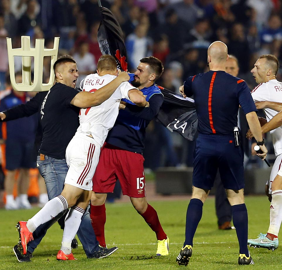 The Euro 2016 Group I qualifying match between Serbia and Albania was suspended after skirmishes involving players and fans over an Albanian flag that was flown above the stadium by a drone.