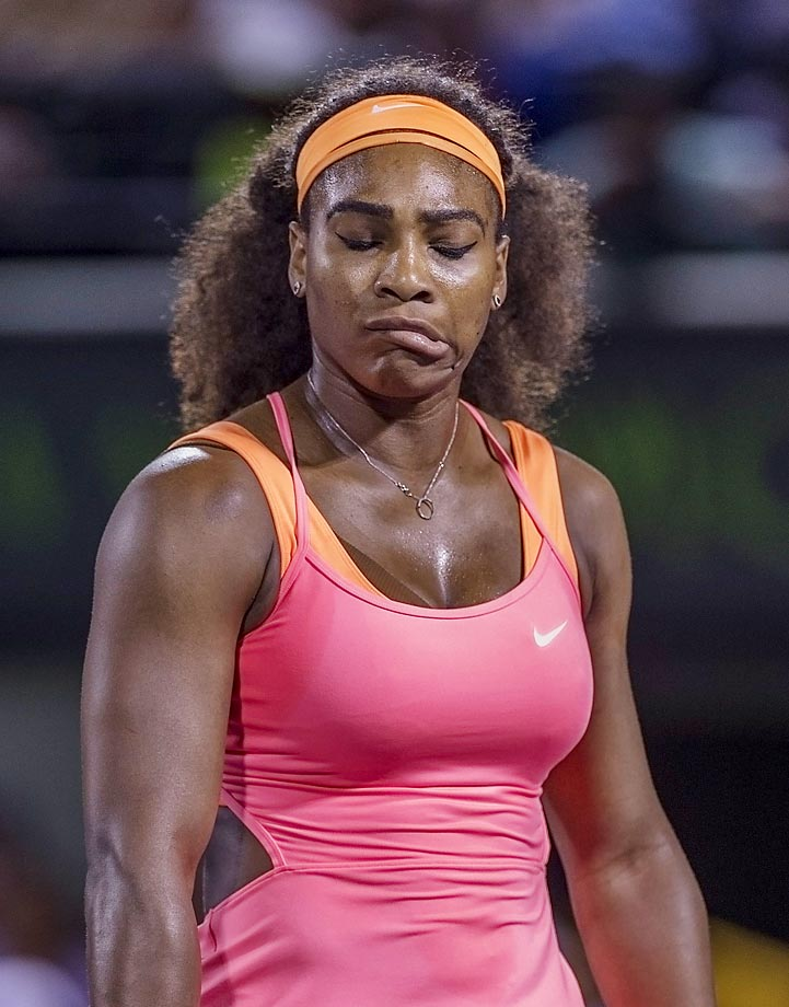 Serena Williams makes a funny face after an unforced error against Simona Halep.