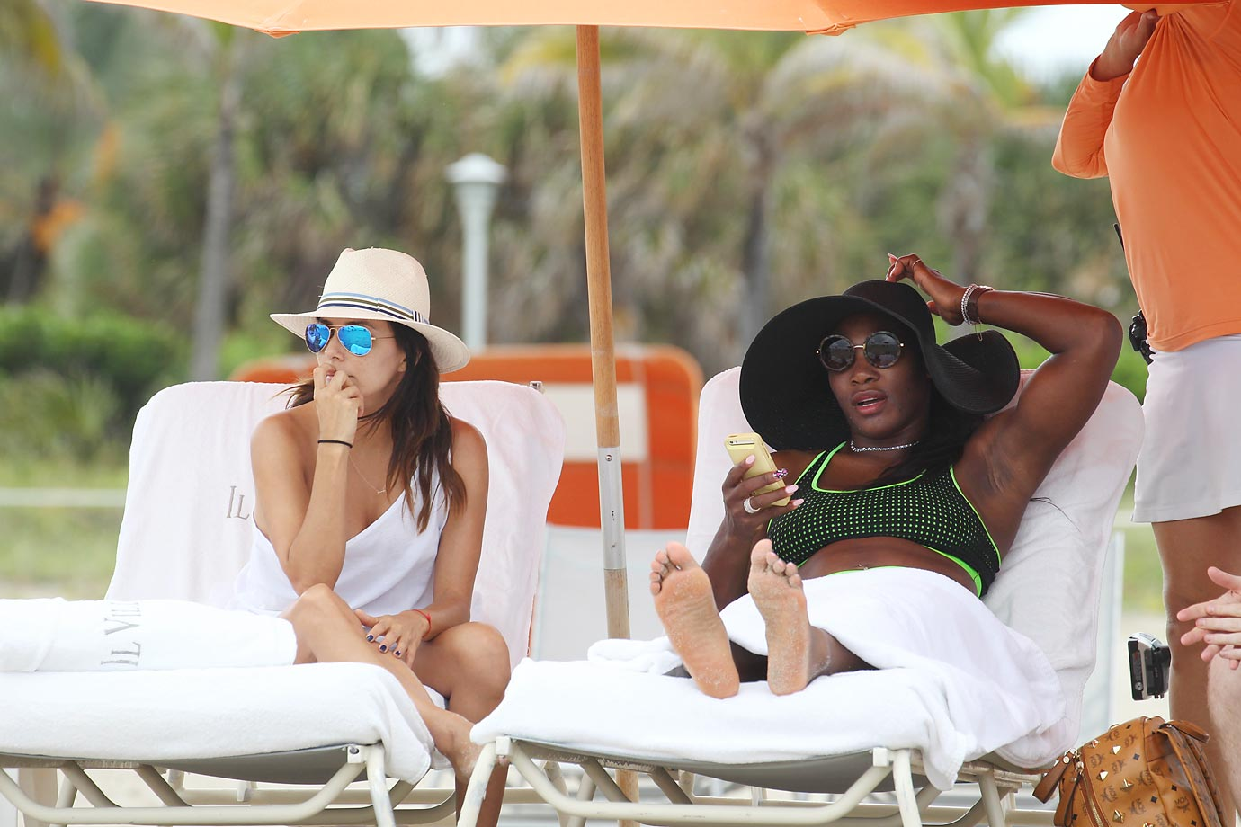 Eva Longoria and Serena Williams on a beach in Miami last week.