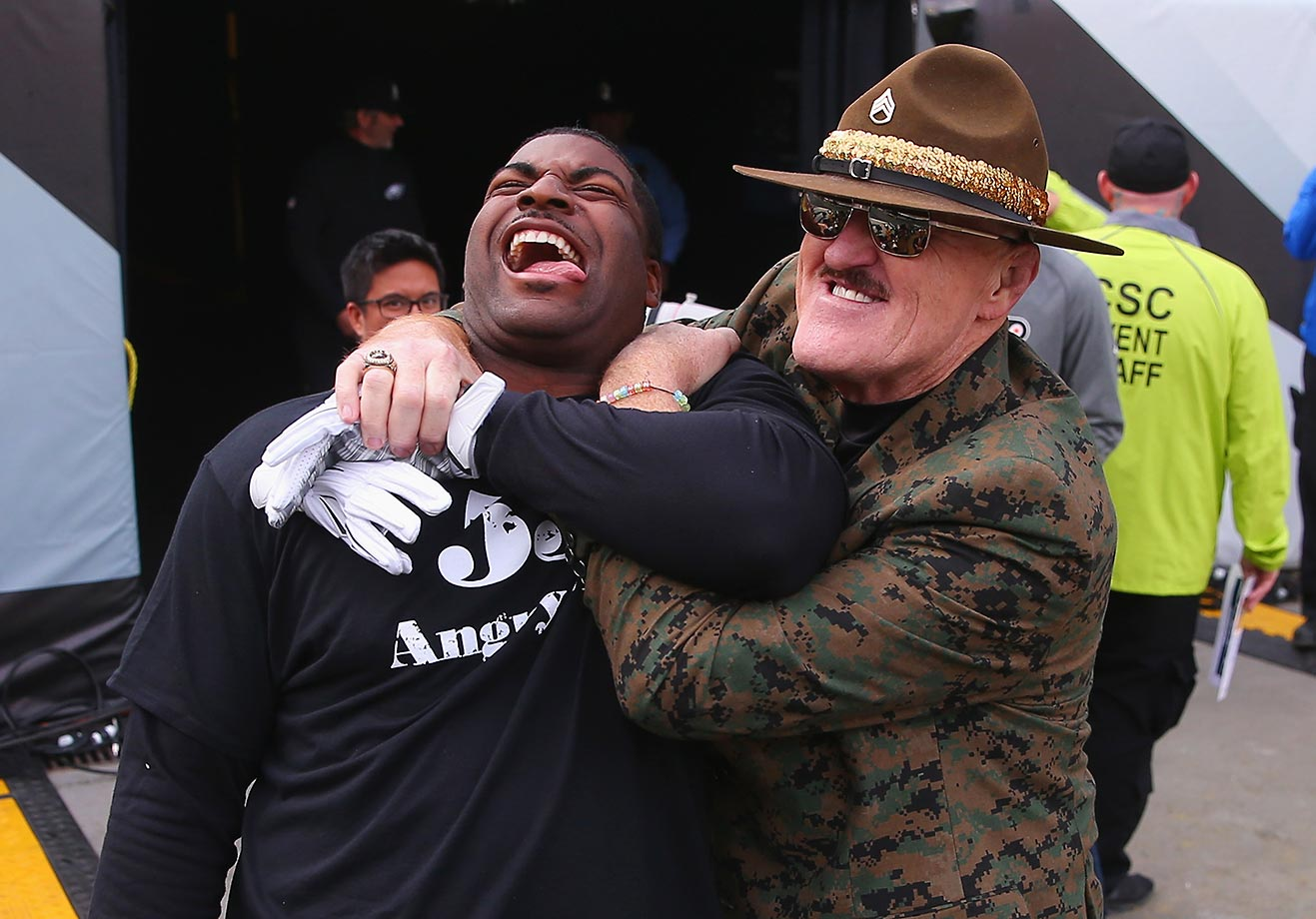 Vinny Curry of the Philadelphia Eagles jokes around with Sgt. Slaughter of the WWE before the game.