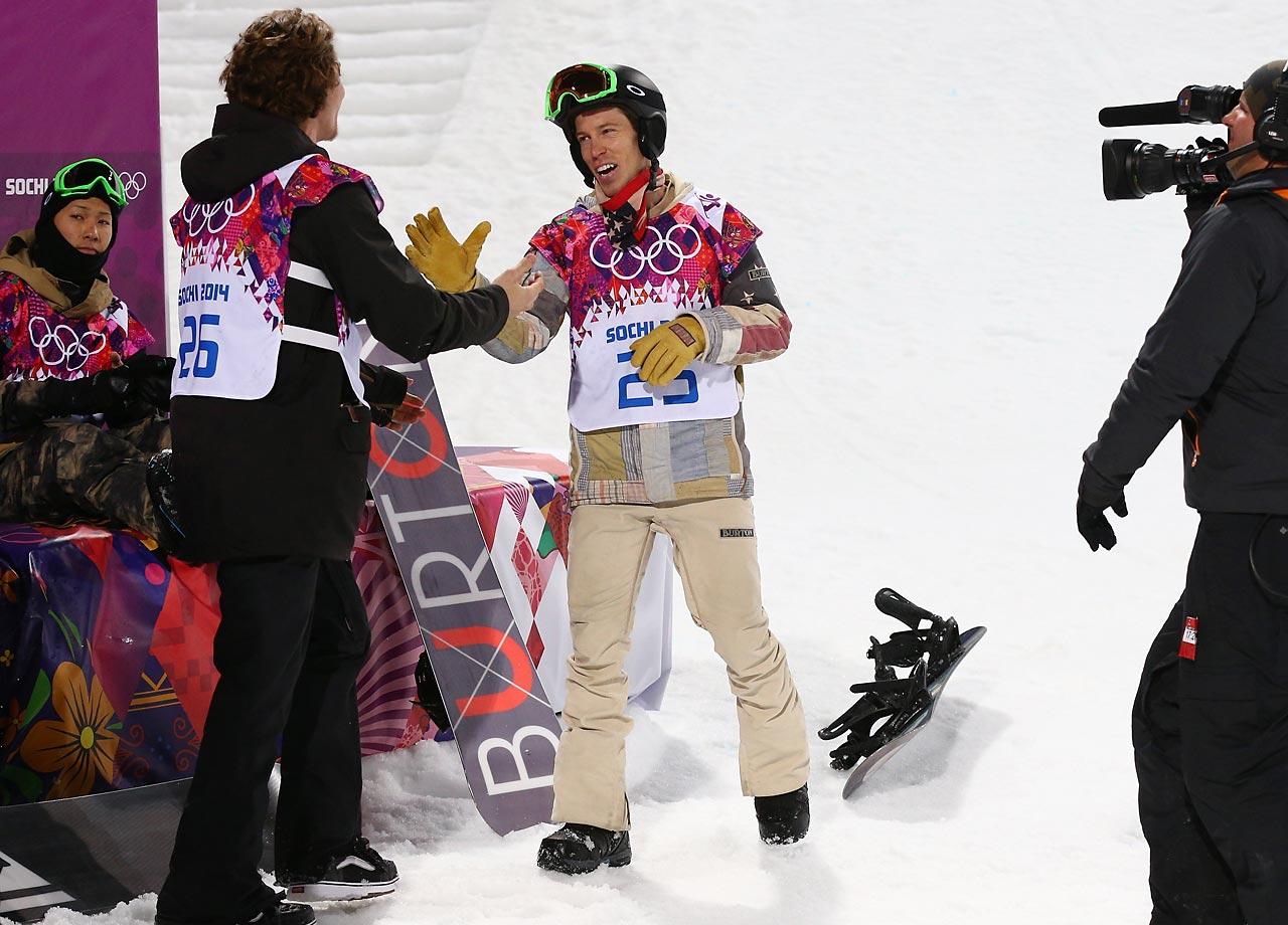 Shaun White congratulates gold medalist Iouri Podladtchikov of Switzerland after the finals.