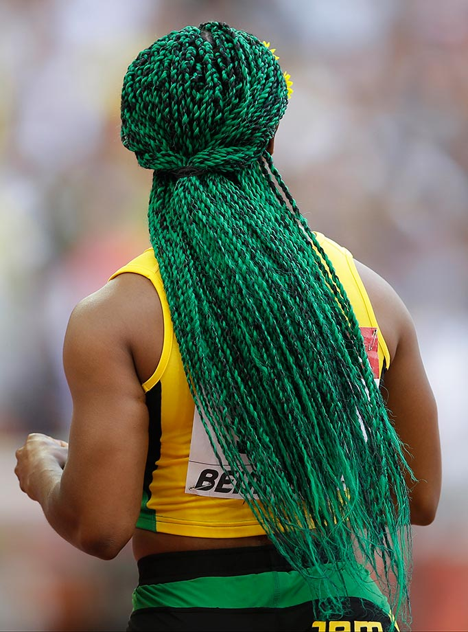 Shelly-Ann Fraser-Pryce sporting Jamaican-styled green hair at the World Athletics Championships in Beijing.