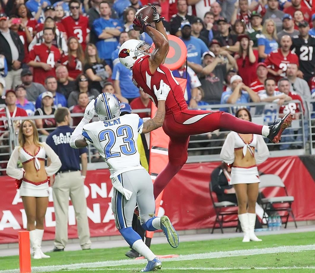 Cardinals receiver Michael Floyd makes his second touchdown catch against the Lions.