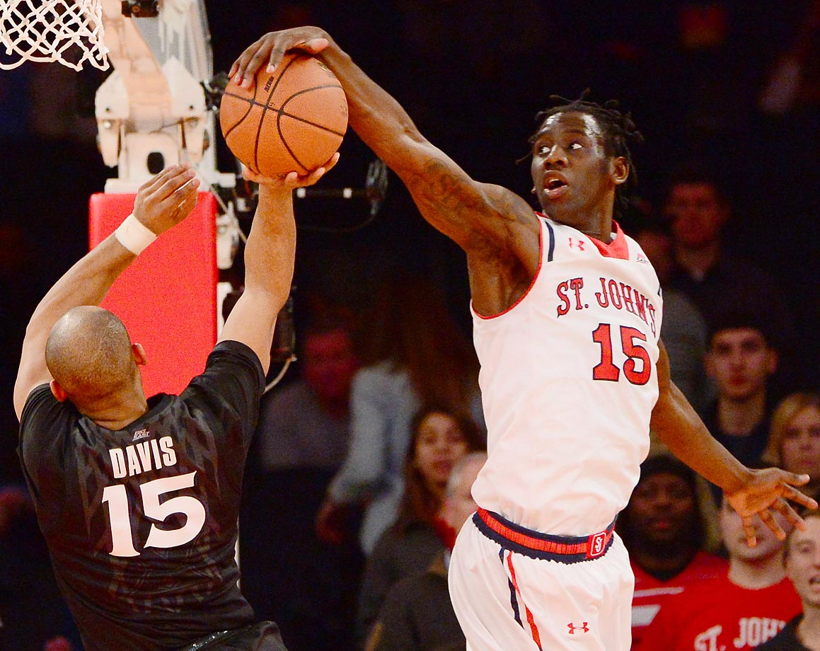 St. John's Red Storm guard Sir'Dominic Pointer makes a convincing block against Xavier.
