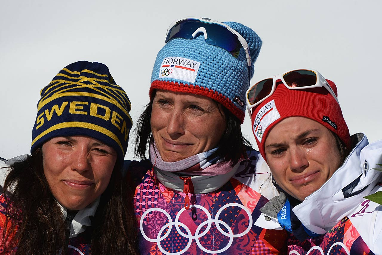 Silver medalist Charlotte Kalla of Sweden, gold medalist Marit Bjoergen of Norway and bronze medalist Heidi Weng of Norway on the podium for the Ladies' Skiathlon 7.5 km Classic + 7.5 km Free.