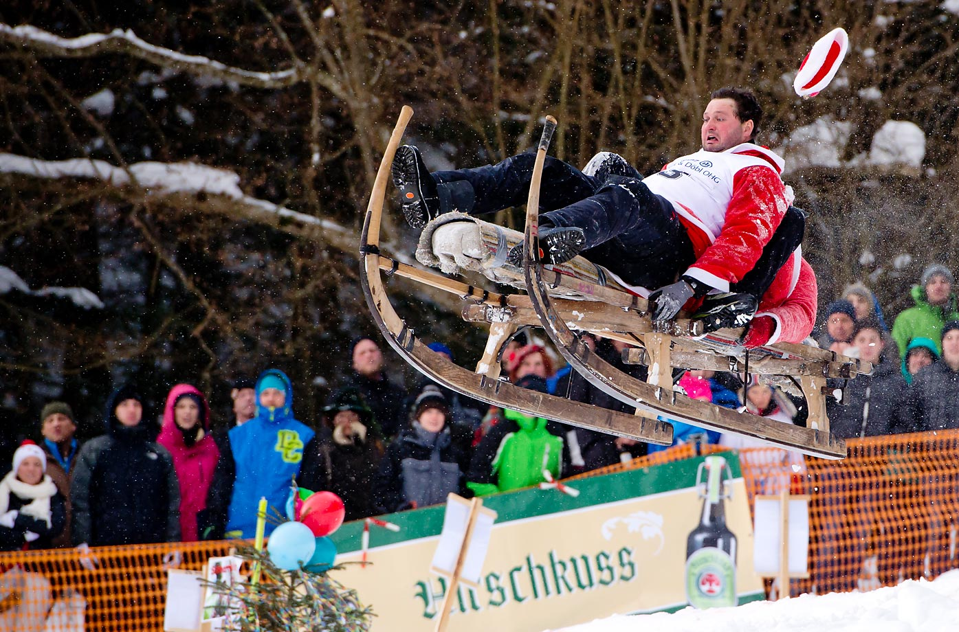 Two costumed participants ride their sled during the traditional Schnablerrennen sled race in Gaissach, Germany. More than  100 costumed sled racers took part in the traditional event.