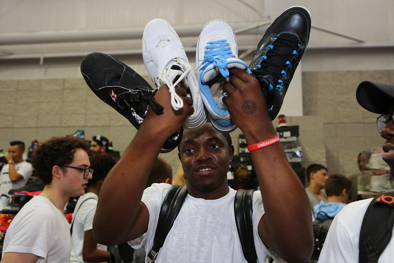 "Known as ""The Greatest Sneaker Show on Earth,"" Sneaker Con returned to New York City last weekend with hundreds of vendors and tens of thousands of sneakers. Seas of shoe fiends filled up the Javits Center in hopes of buying, selling, trading and showing off their sneakers, a sneaker lover's mecca. Check out the scenes from 2015 Sneaker Con."