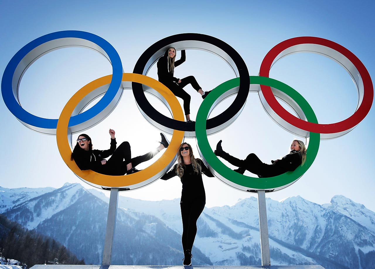 Shelly Gotlieb, Stefi Luxton, Christy Prior and Rebecca Torr of New Zealand pose for a picture with the Olympic Rings at Athletes Village.