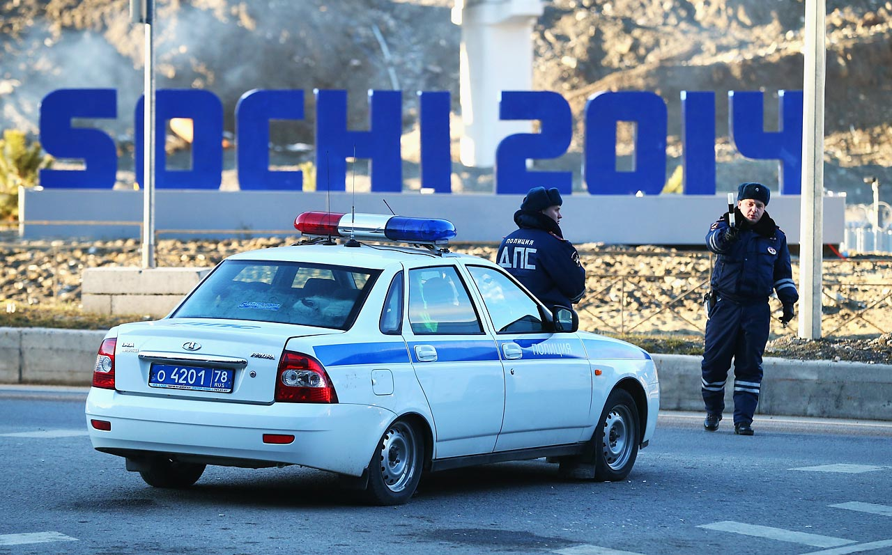 Police stop traffic near the Gorki Media Centre in the Rosa Khutor Moutain Clustera.