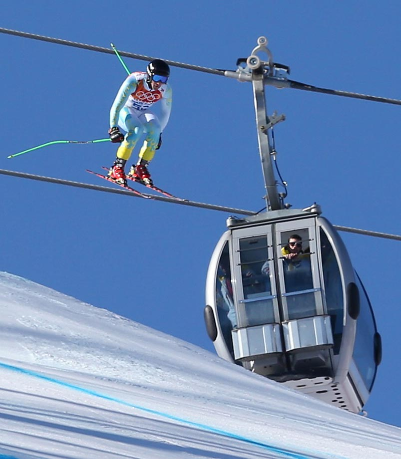Kazakhstan's Igor Zakurdaev makes a jump  during a men's downhill training run.