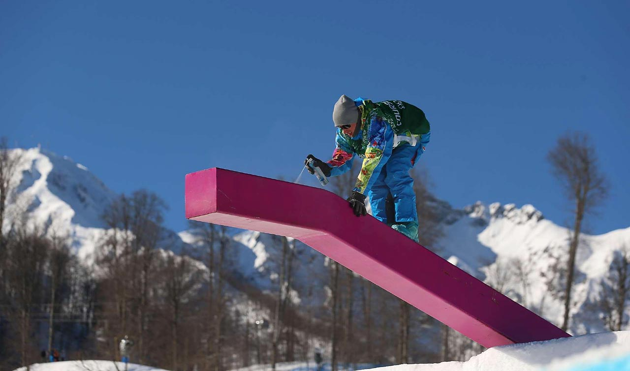 A worker puts on some final touches at the Slopestyle venue.