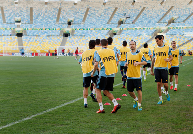 Players from Spain's national team exercise during a training session ahead of the FIFA Confederations Cup Brazil at the Estadio do Maracana, where the Bermuda Celebration grass has been installed in advance of the 2014 World Cup.