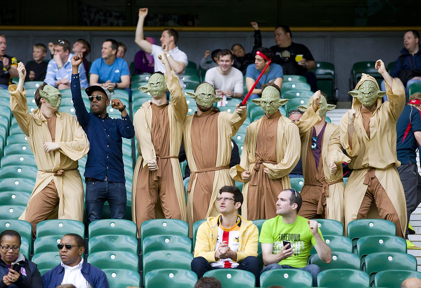 "Fans dressed as ""Yoda"" dance at the London Sevens rugby union event."