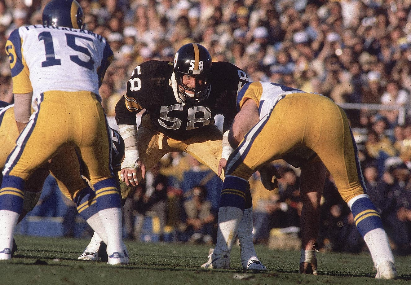 Pittsburgh middle linebacker Jack Lambert gets ready to inflict damage on the Los Angeles Rams in Super Bowl XIV. His fourth-quarter interception helped seal the victory for the Steelers.