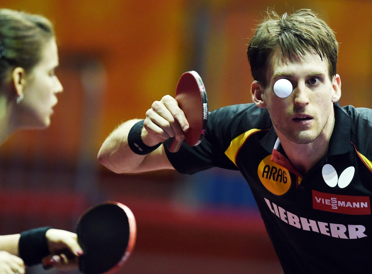 Steffen Mengel has his eye on the ball during the mixed doubles match at the 2015 World Table Tennis Championships.