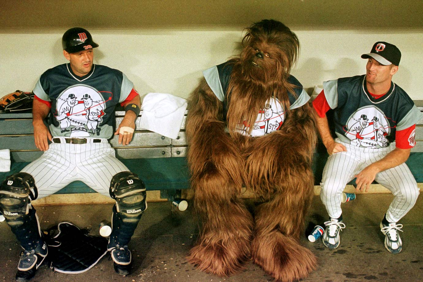 Minnesota Twins catcher Terry Steinbach and pitcher Joe Mays share the bench with the Twins newest Wookie prior to their game with the Seattle Mariners on July 24, 1999 at the Hubert H. Humphrey Metrodome in Minneapolis, Minn.