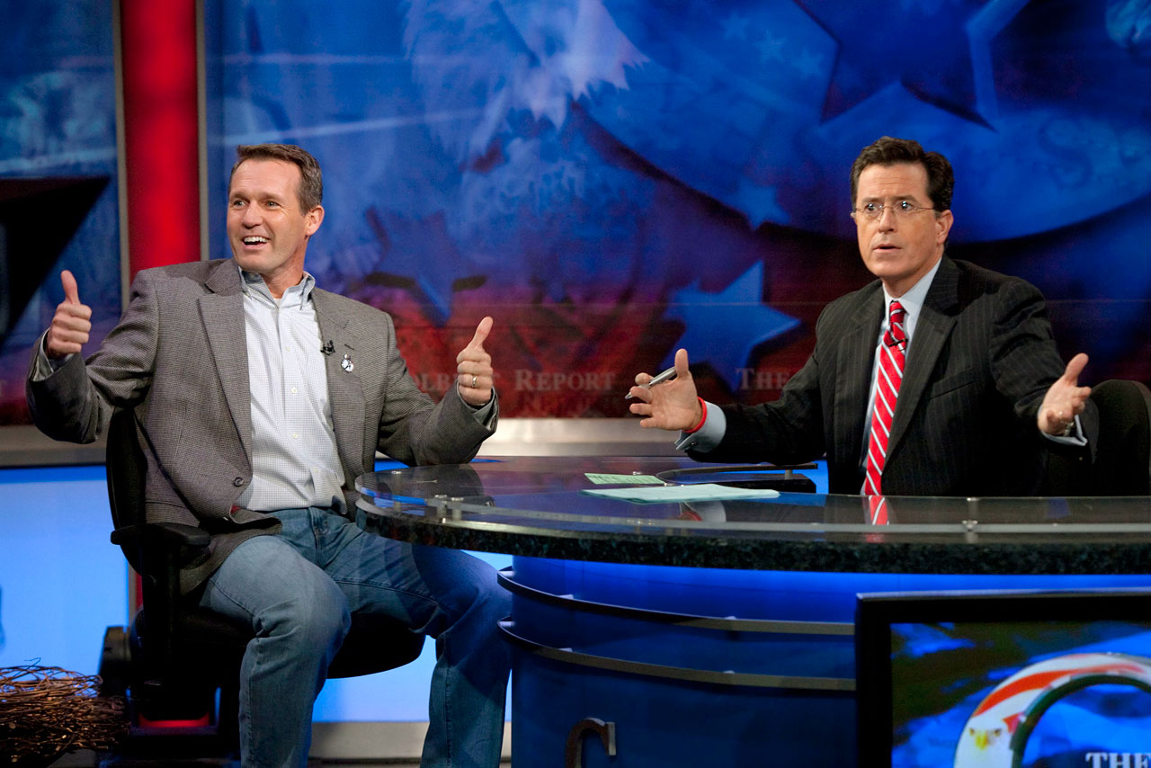 Olympic gold medalist Dan Jansen gives two thumbs up while appearing on The Colbert Report on Nov. 2, 2009 in New York City. Stephen Colbert announced his show had become the primary sponsor of the U.S. Speedskating team at the Vancouver Olympics.