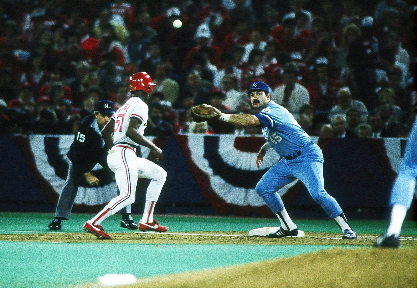 Steve Balboni of the Royals catches a pickoff throw during Game 3.