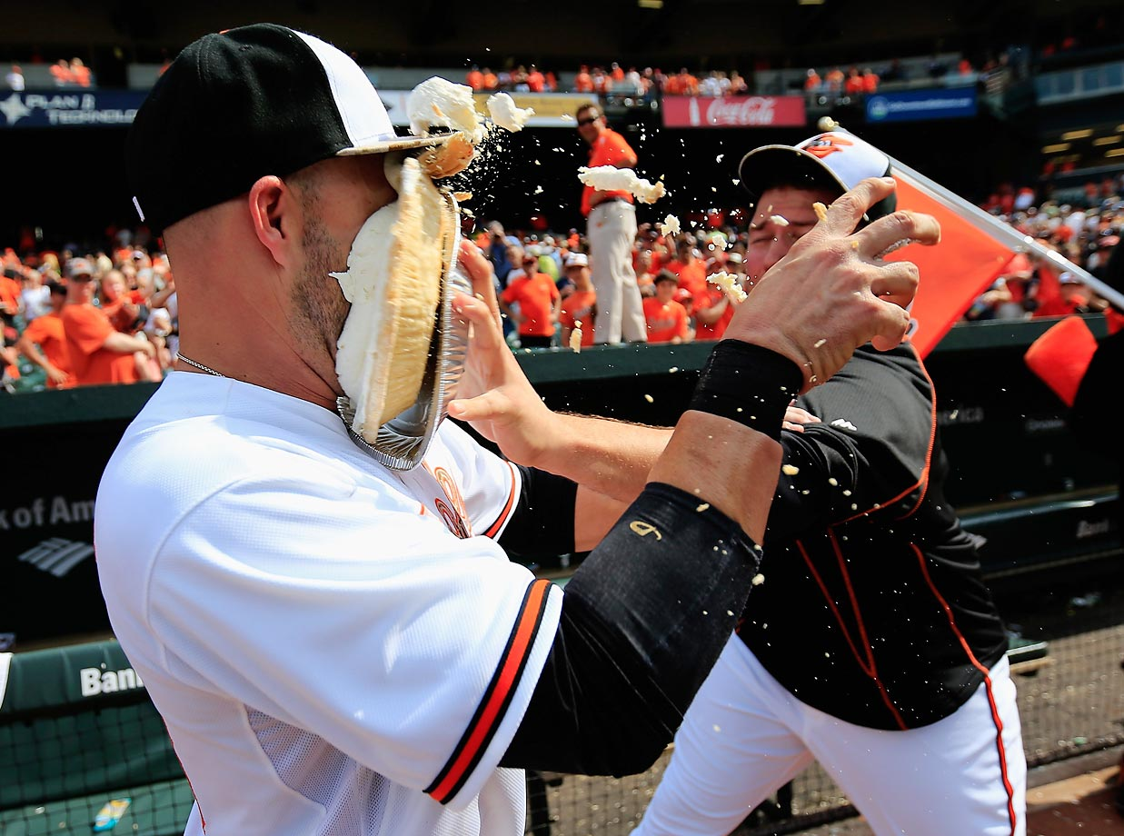 Tommy Hunter of the Baltimore Orioles hits Steve Pearce with a pie following their 4-3 win over the Houston Astros.