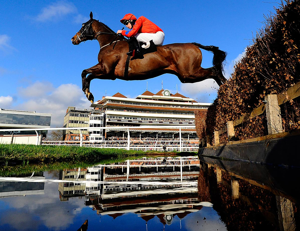 Steven Clements, riding Susquehanna River, clears the water jump during the Burges Salmon Amateur Riders' Handicap Steeple Chase in Newbury, England.
