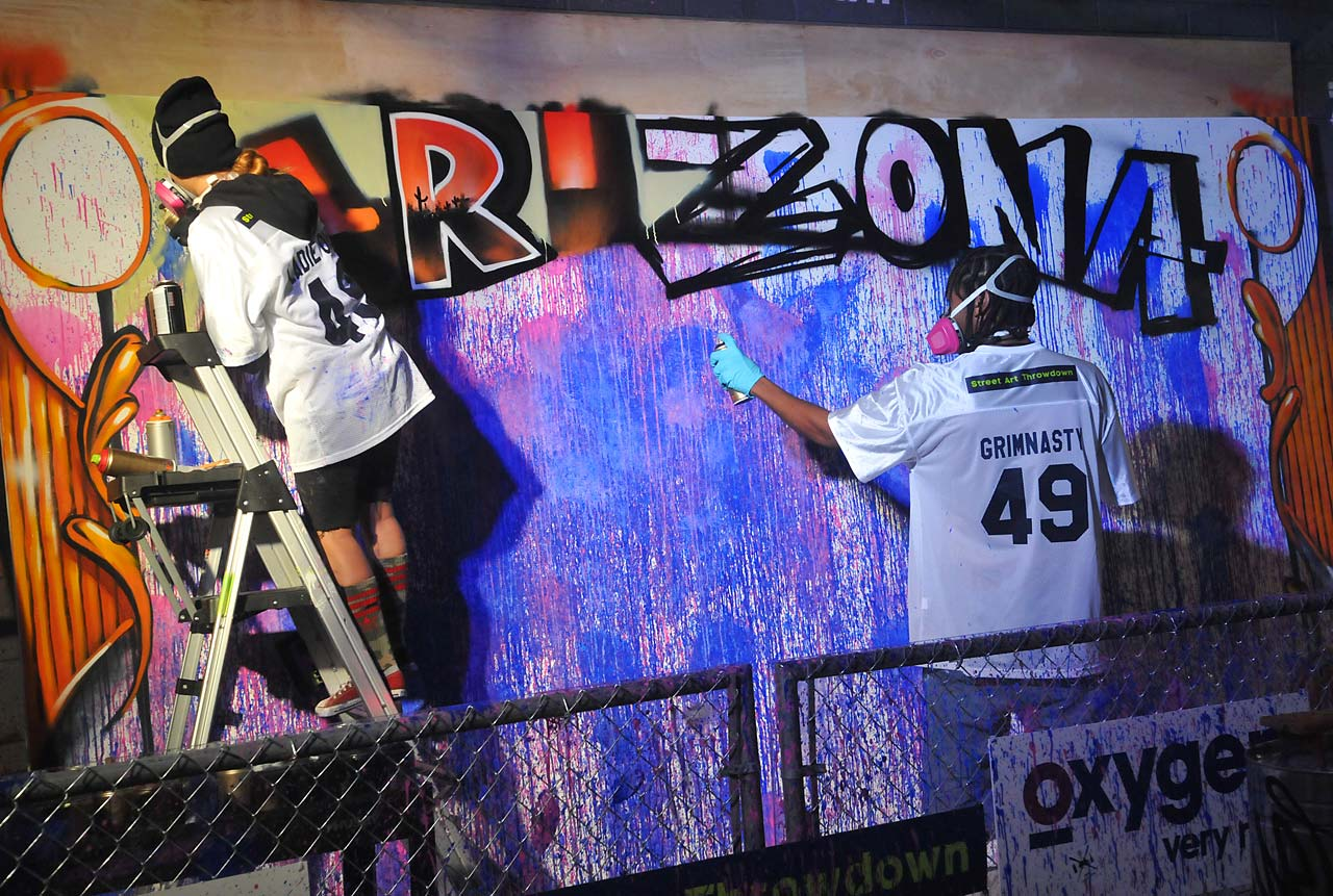 LadieOne (left) and Soloman Perry participate in the 'Oxygen 2015 Super Bowl XLIX Activation'.