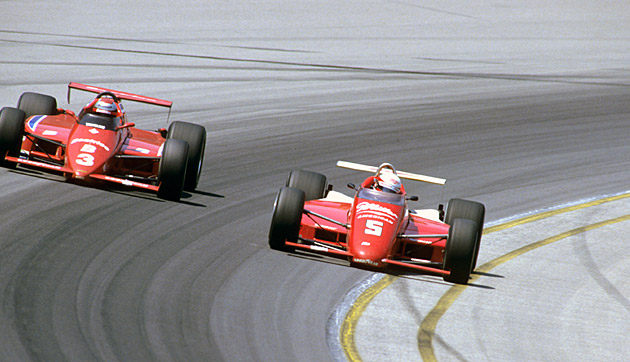 Danny Sullivan (right) passes Mario Andretti en route to the checkers.