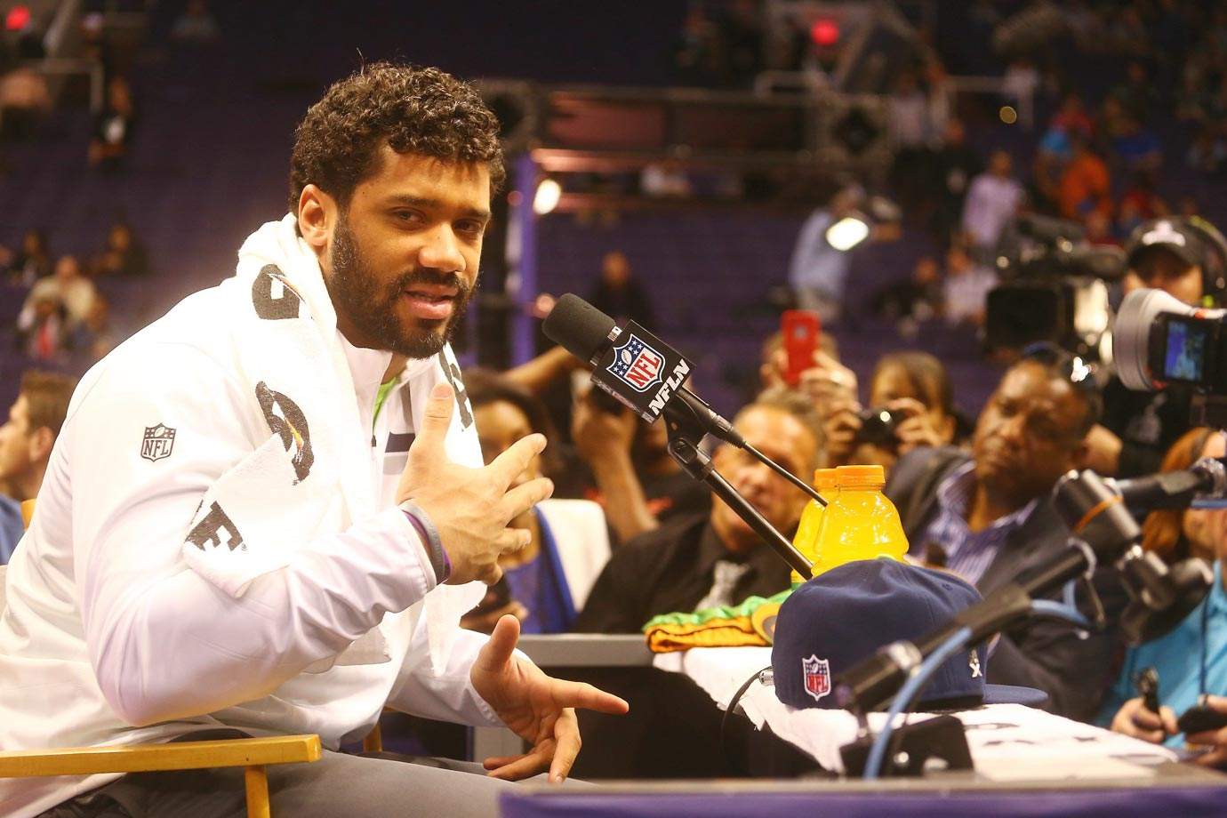 Russell Wilson answers questions at media day.