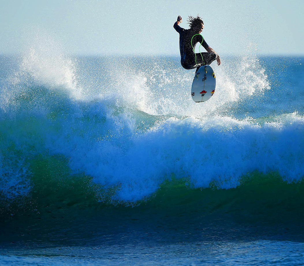 Jordy Smith of South Africa boosting in practice.