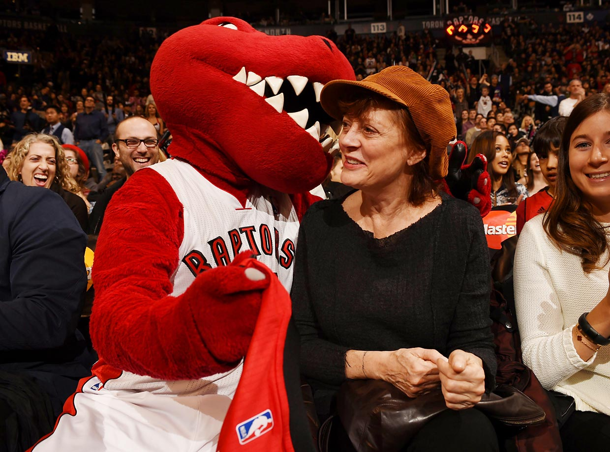 The Toronto Raptors mascot takes a bite out of actress Susan Sarandon during a game against the Celtics.