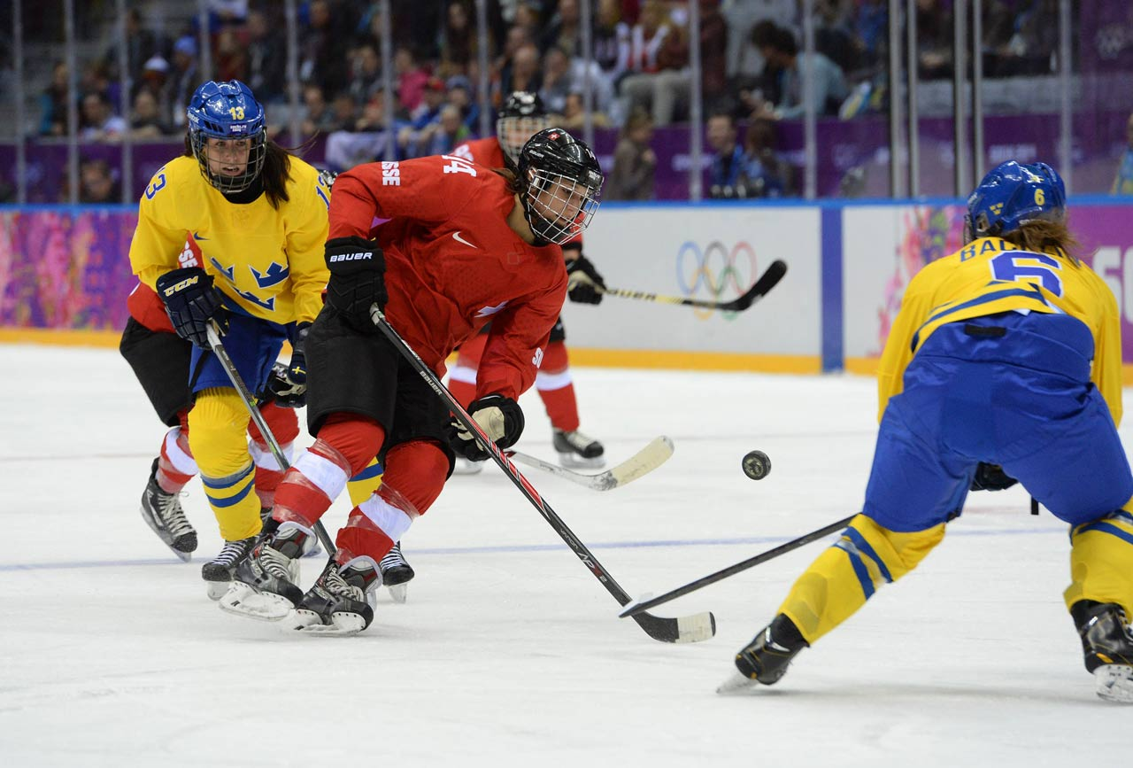 Forward Evelina Raselli (14) controls the puck during Switzerland's victory.